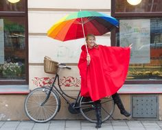 Red Rainproof Bike Cape:An irressistibly cute bike poncho, Red Riding Hood style. Don't let the unexpected rain stop you from cycling on.