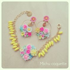 make these yellow beads out of clay. make earrings that are hoops with flowers.