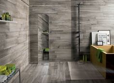 dark Grey wooden floor and wall tiled room with green accents