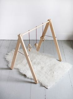 DIY Wooden Baby Gym foldable - and looks so similar to the one I made my baby boy.