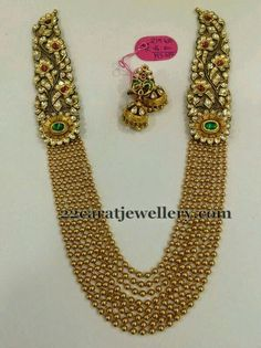 Shree laxmi jewellers Eight similar patterned gold swirls strings haram in antique work. Kundan jadau patterned floral theme embellished motifs comes on the ed. India Jewelry, Temple Jewellery, Pearl Jewelry, Wedding Jewelry, Gold Jewelry, Jewellery Box, Jewellery Shops, Jewelry Stores, Necklaces