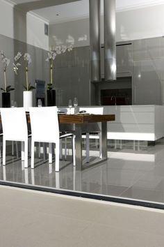 Love grey floor tiles & white kitchen bench.