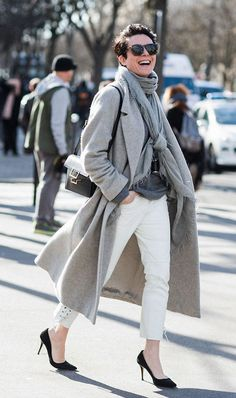 Photo via: Sandra Semburg Achieve the french girl-approved look by pairing tonal colors together. This editor wore a gray coat, gray scarf and darker hued gray t-shirt with white jeans and black acces