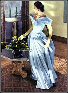 Dorian Leigh in evening gown of satin and faille by Charles James, photo by Cecil Beaton (also used for Modess ad), Vogue, June 1, 1948
