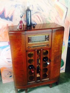 Repurposed Wine Storage using 1940's  GE Shortwave radio cabinet with original  call letters  on the push buttons .  Holds 10 bottles . wood is in excellent condition.