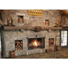 Rock fireplace with rough wood beam mantle.