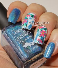 Floral nail art on blue holo brush strokes on white