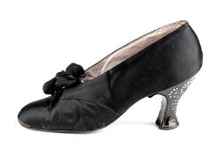 Black satin shoes with, decorated with rhinestones on the heels and a bow on the vamp, 1900-1919