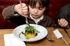 This is my hubby's nephew at Verjus restaurant in Paris. French kids DO eat everything. It is true!!