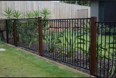 iron fence with wooden Balustrades