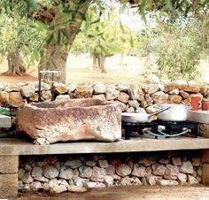 Outdoor kitchen w/ stone sink