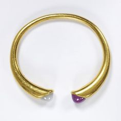 """August Hollming (FI) for Fabergé (RU), antique gold bangle, based on Roman jewelry, set with a ruby and a sapphire, Russia, St Petersburg, 1908-13. 