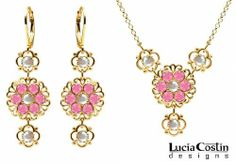 Lucia Costin Necklace and Earrings Set Made in 14K Yellow Gold Plated over .925 Sterling Silver with Filigree Ornaments, White and Pink Swarovski Crystals, Crafted with 4 Petal Flowers Lucia Costin. $124.00. Lucia Costin floral jewelry set. Style takes wings in this lovely jewelry set that have a graceful flower shape. Handmade in USA unique jewelry set. Flowers and fancy ornaments beautifully combined. Beautifully designed with aurora borealis and rose Swarovski c...