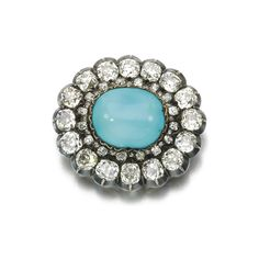 Turquoise and diamond brooch/pendant, late 19th century. Set with a polished turquoise framed by cushion-shaped and rose diamonds.