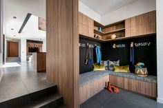 Entry storage integrated with chalkboard and seating for functional coming/going: Daniel Cassettai Design in Perth, Australia