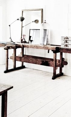 = vintage workbench table and white floorboards