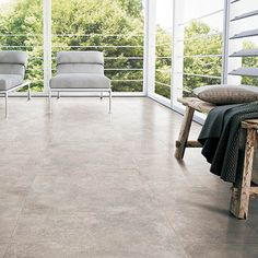 Polished Concrete Effect Porcelain Floor Tiles In Beige Colour Give A Warm Chic Look To This Stylish Raised Patio Area