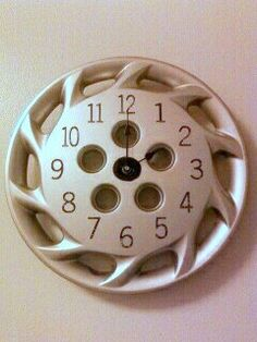"""UpCycled Hubcap Clock 15.5"""" Diameter Finished With Numbers by TransCreation."""