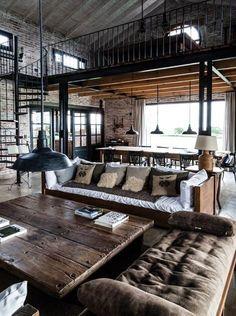 Wohnung, Loft im Industrielook. Einrichtung hier dezent aber kraftvoll umgesetzt mit Leder und Industrierohren.