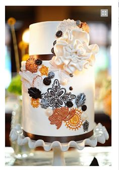 If your wedding, and your budget is smaller, put your cake on a fabulous stand to add height and drama.