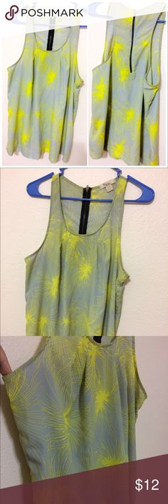 XXI highlighter yellow and lavender/grey tank top This XXI forever 21 highlighter yellow and lavender/grey tank top is very bright! Has an airy flow to it. Has a highliter yellow/green design all over and the background is a lavender/grey color. The colors on this shirt can play tricks on your eyes! I thought it was grey when I first purchased but in photos it looks purple! Either way very beautiful. Has a zipper on the back that is black. Forever 21 Tops Tank Tops