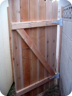 DIY Gate Tutorial-Next cut a diagonal brace for the back of the gate and attach ., DIY, DIY Gate Tutorial-Next cut a diagonal brace for the back of the gate and attach each gate slat to the brace. This will add strength to the gate. Diy Gate, Diy Fence, Backyard Projects, Outdoor Projects, Garden Projects, Backyard Gates, Building A Gate, Wooden Gates, Wood Fence Gates