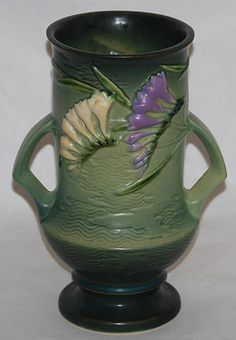 "Roseville Pottery - I've been collecting Roseville for a while....my favorite pattern is ""Freesia"""