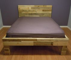 I like the headboard on this, Taylor Jolley ;) DIY Pallet Bed | 101 Pallets