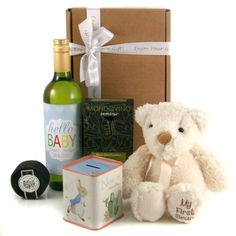 """This is such a beautiful and personal baby gift set for both the new baby boy and the new proud parents. Included is baby's first teddy bear he's super soft and cuddly with the softest cutest brown nose. For the new parents we've designed and printed labelling for the wine bottle. You can personalise the wine label with the baby boy's name and his birth date. The wording """"Hello Baby"""" is fixed so can't be changed."""