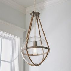 Coastal Cottage Rope Globe Pendant Combining blown glass, rope accents and rustic charm, this collection features two finishes that complement a myriad of styles from modern farmhouse and urban loft to classic colonial and coastal cottage. Beach Cottage Style, Beach Cottage Decor, Coastal Cottage, Coastal Homes, Coastal Style, Coastal Living, Coastal Decor, Modern Beach Decor, Beach Cottage Bedrooms