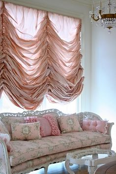 This room is much too 'delicate' and pink for me... but that window curtain is stunning ... I LOVE the drappyness of it