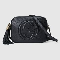 Shop the Soho small leather disco bag by Gucci. A compact shoulder bag with a leather tassel zipper pull. Sized to fit the necessities. Made in our light, natural grain leather.