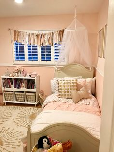 Bella's blush pink and gold room. The mosquito net and gold dot sheets are from Pottery Barn Kids while the blush duvet cover is from Restoration Hardware Baby and Child.