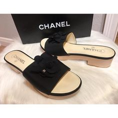 Get the must-have mules of this season! These Chanel Black Cc Camellia Grosgrain Wood Platform Slip On Sandals - Mules/Slides Size EU 40 (Approx. US Regular (M, B) are a top 10 member favorite on Tradesy. Save on yours before they're sold out! Chanel Mules, Chanel Sandals, Mule Sandals, Chanel Box, Chanel Brand, Chanel Camellia, Kinds Of Shoes, Wearing Black, Black Heels