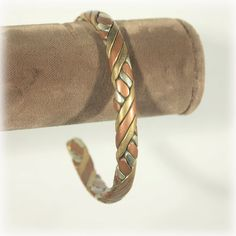 Silver Copper and Brass Braided Bangle by JunkboxTreasures on Etsy, $22.00