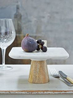 Serve your finest bakes on our elegant cake stand, which combines bare wood and cool marble in contemporary Scandi style. Nordic House £56