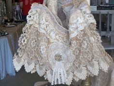 *This bag is made using vintage old lace and trims......adorned with a vintage jewel! Go to a Flea market<3