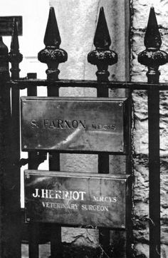 The brass plates outside Skeldale House, announcing S. Farnon and J. Herriot, veterinary surgeons. These were displayed at Cringley, Main Street, Askrigg, Wensleydale, North Yorkshire for the filming of the BBC TV series All Creatures Great And Small