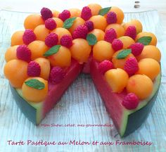 What a cute serving idea - watermelon 'cake' topped with fresh rockmelon balls, raspberries and mint.  Perfect summer treat.