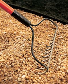 Pour enough gravel to come about ½ inch shy of the top of the edging and rake it out evenly. Maintain the path by occasionally raking it smooth and refilling it with more gravel, as necessary.