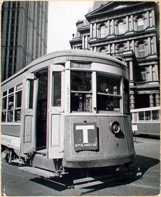 Old Post Office with Trolley - II, Park Row and Broadway, Manhattan by Berenice Abbott Art Block Manhattan Nyc, Lower Manhattan, Old Post Office, Berenice Abbott, New York Photos, History Of Photography, Modern Metropolis, City Architecture, New York Public Library