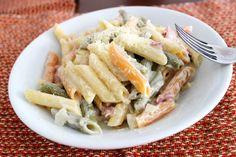Penne tricolore (three-colored) with bacon, peas, raisin and white lemon sauce