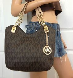 Marie* i know its mk* lol* dont care for the name brand* but i love the style...would like bigger straps as well along with the short ones