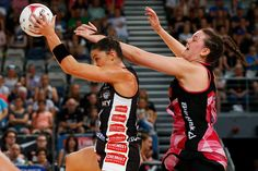 Sharni Layton of the Magpies and Jane Cook of the Thunderbirds contest the ball during the round four Super Netball match between the Magpies and the Thunderbirds at Hisense Arena on March 12, 2017 in Melbourne, Australia.