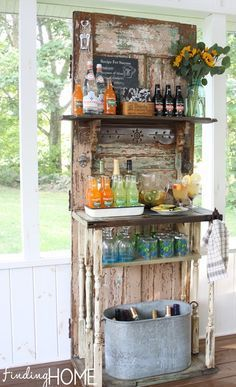 Warm Weather Outdoor Decorating Ideas - Finding Home. A beverage bar repurposing an old door. Sweet!