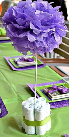 Baby Sprinkle Centerpiece - Blue or white poms - add paper or crystal rain drops, and use black/white or gold ribbons to tie diapers together. Cute idea for center pieces for a baby shower/sprinkle without using real flowers. Idee Baby Shower, Mesas Para Baby Shower, Diaper Shower, Baby Shower Games, Baby Boy Shower, Shower Party, Baby Shower Parties, Shower Gifts, Baby Showers