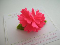 Zig Zag wool felt flower in coral on a 1.25 inch by lilchatterbox, $6.00