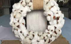 made with cotton balls, pine cones, and styrofoam wreath form wrapped in white fabric image