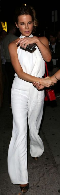 Who made  Kate Beckinsale's white jumpsuit, platform pumps, and red handbag?