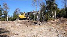Volvo 210 Excavator Extending Pond - YouTube